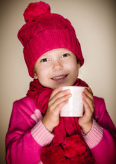 Young girl smiling and enjoying a cup