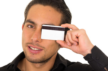closeup portrait of handsome young man holding credit card