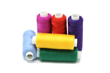 several coils with color threads on a white background