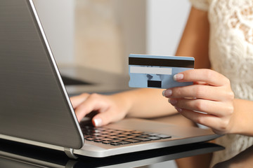 Woman buying online with a credit card ecommerce