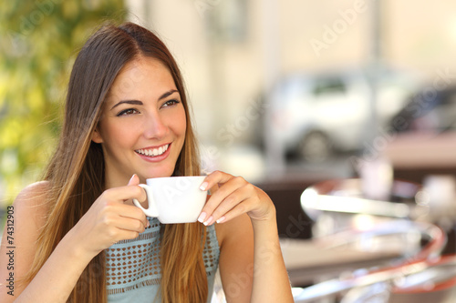 Pensive woman thinking in a coffee shop terrace - 74312903