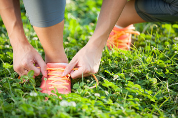 Runner trying running shoes getting ready for jogging