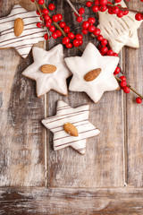Gingerbread cookies in star shape decorated with almonds