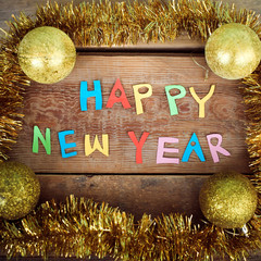 Happy New Year text  on wood background