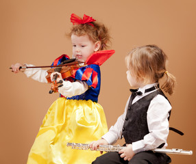 Young girls holding musical Instruments