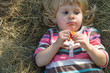 little girl in haystack
