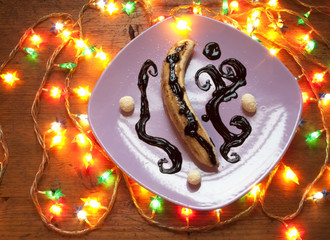 Caramelized banana and chocolate syrup on a plate
