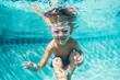 Leinwandbild Motiv Young Boy Diving Underwater in Swimming Pool