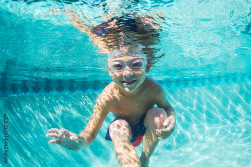 Young Boy Diving Underwater in Swimming Pool - 74316129