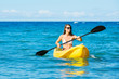 Woman Kayaking in the Ocean on Vacation - 74316351