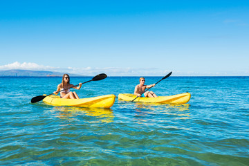 Man and Woman Kayaking in the Ocean
