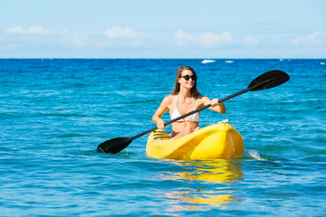 Woman Kayaking in the Ocean on Vacation
