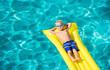 Leinwanddruck Bild - Young Kid Having Fun in Swimming Pool