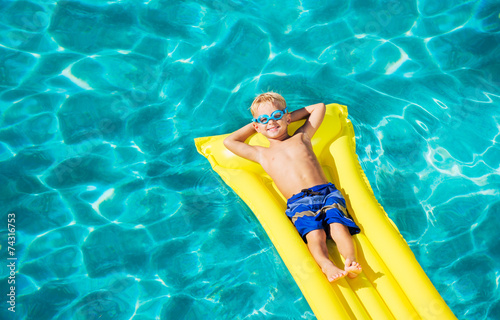 Leinwanddruck Bild Young Kid Having Fun in Swimming Pool