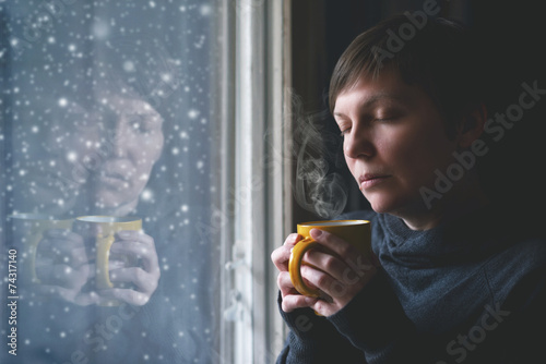 Lonesome Woman Drinking Coffee in Dark Room - 74317140