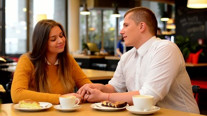 happy couple talk in cafe - couple holding hands