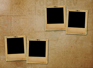 Old paper slides for photos on rusty abstract background