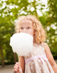 Picture of lovely girl eating cotton candy