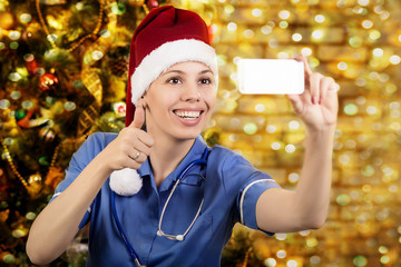 Doctor in cap of Santa. photographs the itselfv