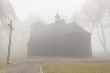 Old wooden church - foggy day, Poland.