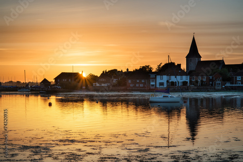 Beautiful Summer sunset landscape over low tide harbor with moor © veneratio