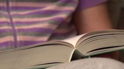 woman reading a book, close up, dolly 2