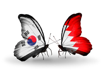 Two butterflies with flags South Korea and Bahrain