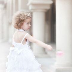 Little girl in wedding dress