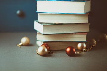 Christmas decoration  and books on gray table