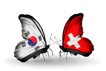 Two butterflies with flags South Korea and Switzerland