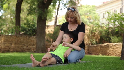 mother and son having fun in the park 4