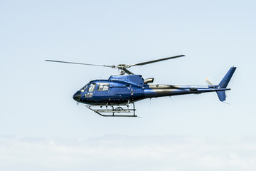 Helicopter flying on blue sky