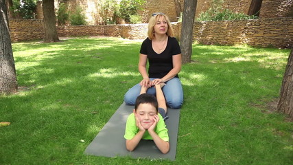 mother and son having fun in the park 1