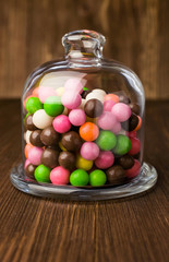 Colorful candies in a glass bell