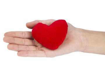 Red heart in woman hand on white