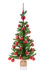 Decorated Christmas tree with peak balls over a white background