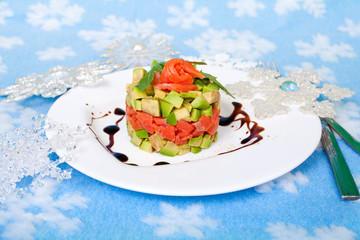 Appetizer of salmon and avocado and Christmas decor