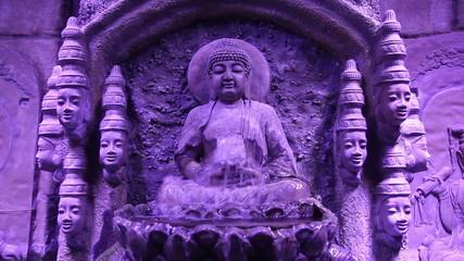 Buddha statue and fountain, purple filter