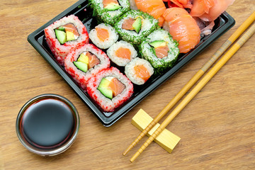 Japanese cuisine: rolls and sushi on a bamboo board close-up.