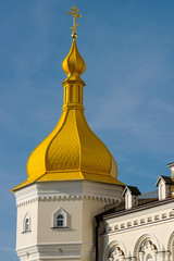 Church tower with a dome against the sky