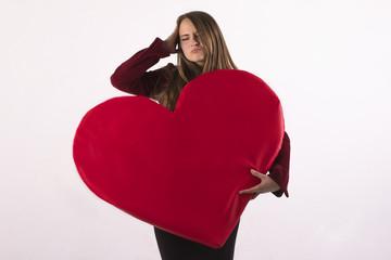 beautiful woman holding a big heart