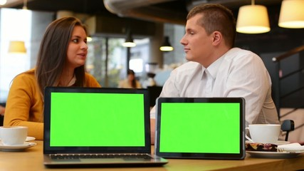computer and tablet green screen - happy couple smiles