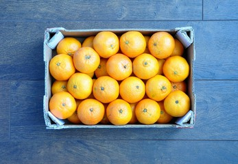 Sweet clementines in a box