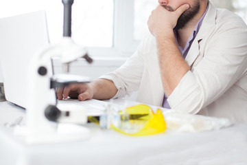 Young Doctor thinking during of using computer