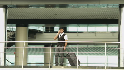 The businessman walk by business center or balcony and talk