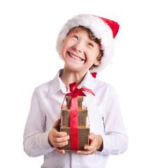 Happy boy holding christmas present wondering wat is inside