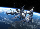 Space Shuttle And Space Station In Space - 74329187