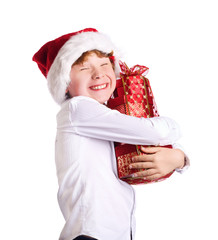 Boy holding christmas present with happy expression on his face