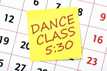 Dance Class reminder note on a wall calendar