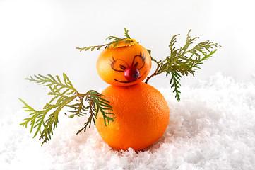 Mandarins as a snowman on christmas